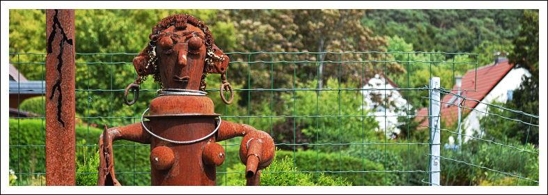 Metallskulptur als Reklame für ein Friseurstübchen